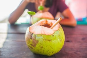 bamboo straw in a coconut