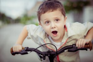 happy child riding his bicycle
